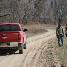 Anne and Paige talking with Jean-Paul (in the truck) while measuring out the market garden to start the year.